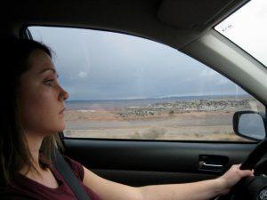 Girl driving a car.