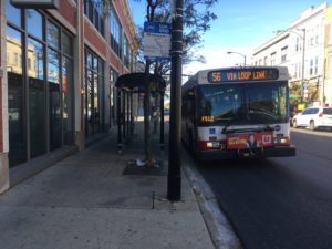 CIty of MIlwaukee bus on a city street.