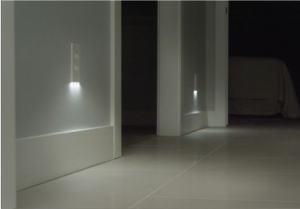A hallway floor and smart outlets with LED lights.