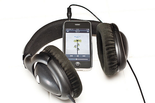 Big headphones attached to an iPhone