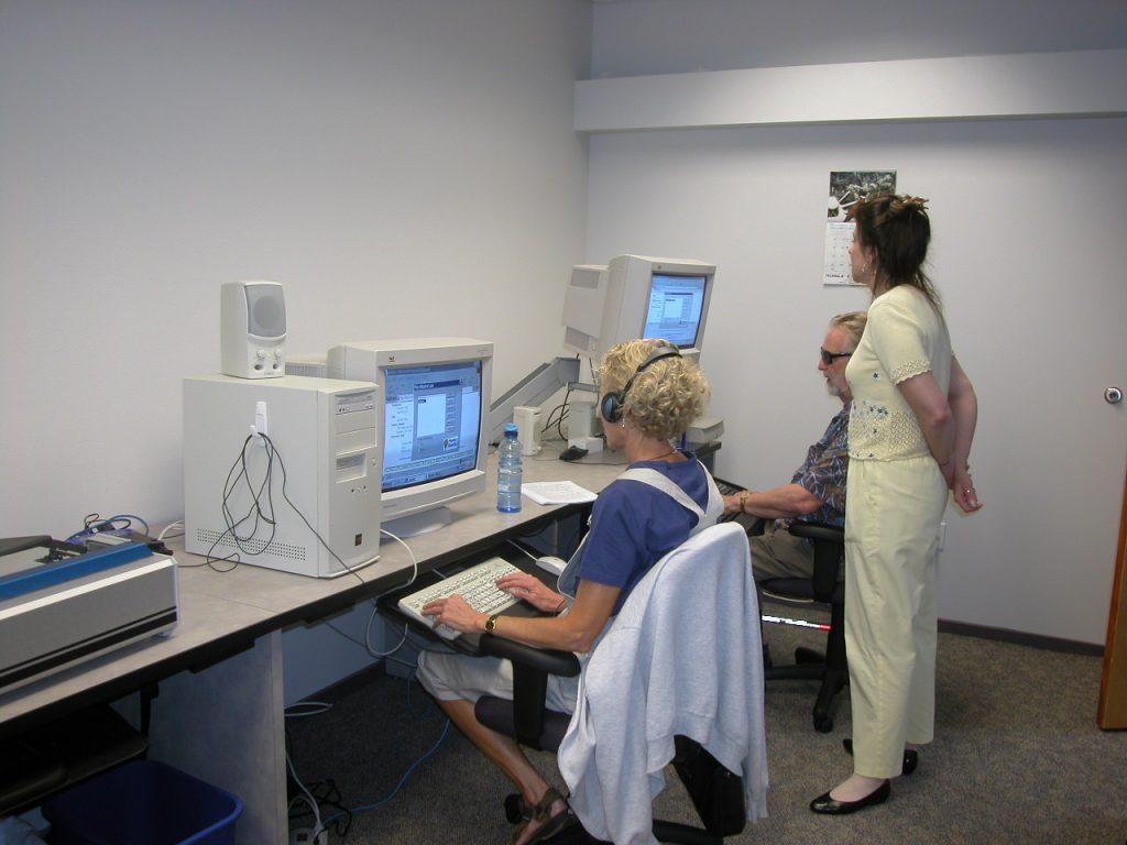 Three people using computers.