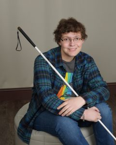Young Man smiling with white cane