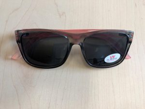 "Sunglasses with a sticker that says ""UV Eye Protection."""