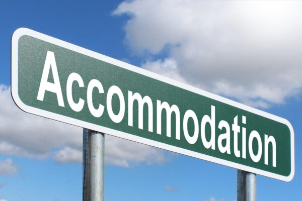 Road sign with accommodation written on it