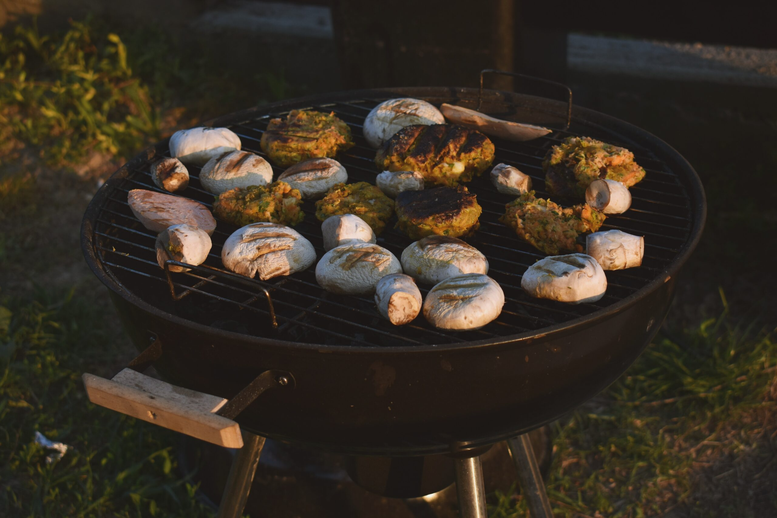 Assorted food on black grill outdoors