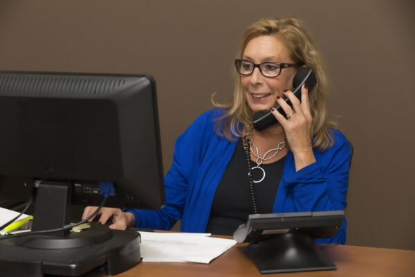 Woman sitting at a desk talking on the phone