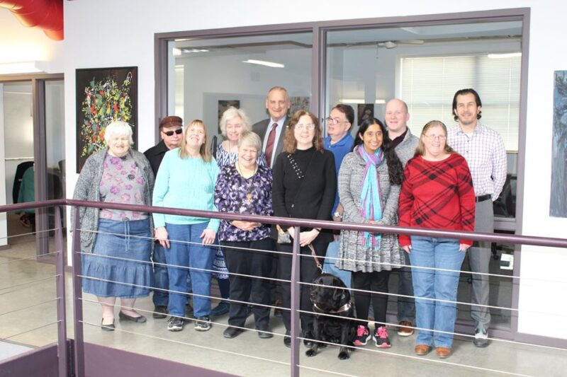 Members of the board pose for a photo inside the Council