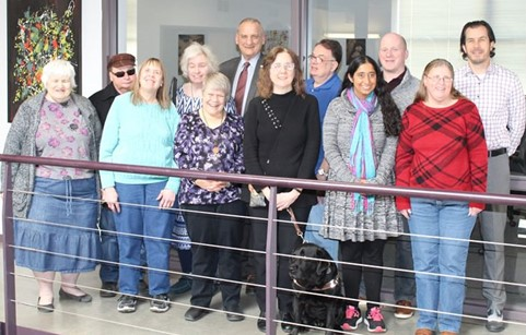 Our 12-member Board of Directors and a guide dog gathered at the Council offices.
