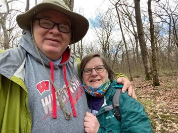 Jon Uzzel and Ellen Connor on a wooded trail.