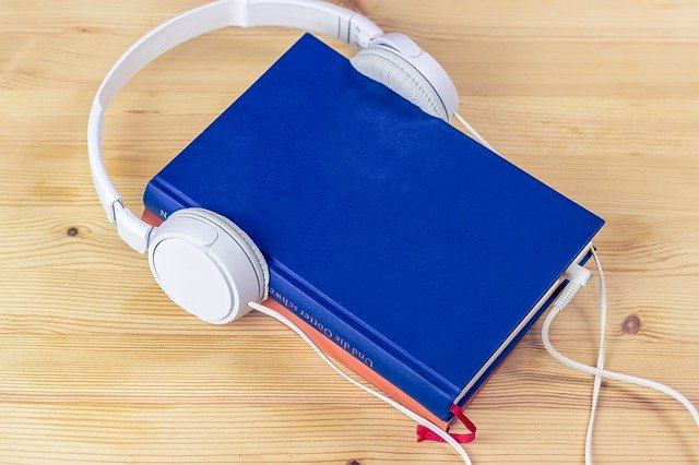 Blue book on table with headphones