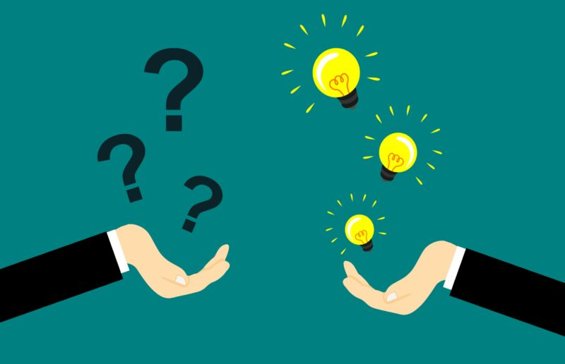 Graphic of one hand hold question marks and one hand holding light bulbs (ideas)