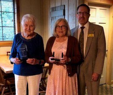Doris Dolph, Suzy DeVriend holding awards with Robert BestBest.