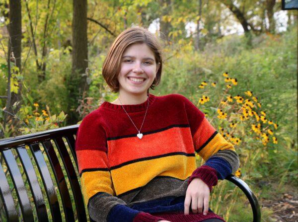 Ellie Thompson sitting on a bench