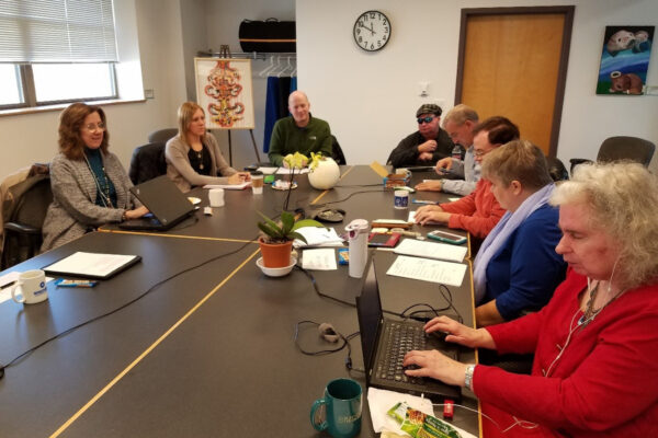 Members of the WCBVI board sitting at a large table.