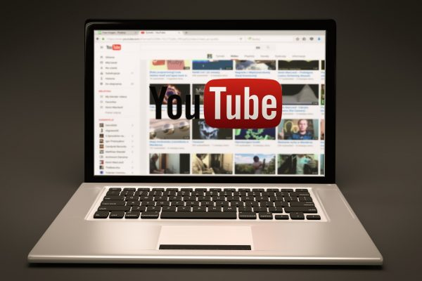 Laptop computer with YouTube page on screen